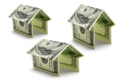 Hundred dollars US notes in shapes of houses
